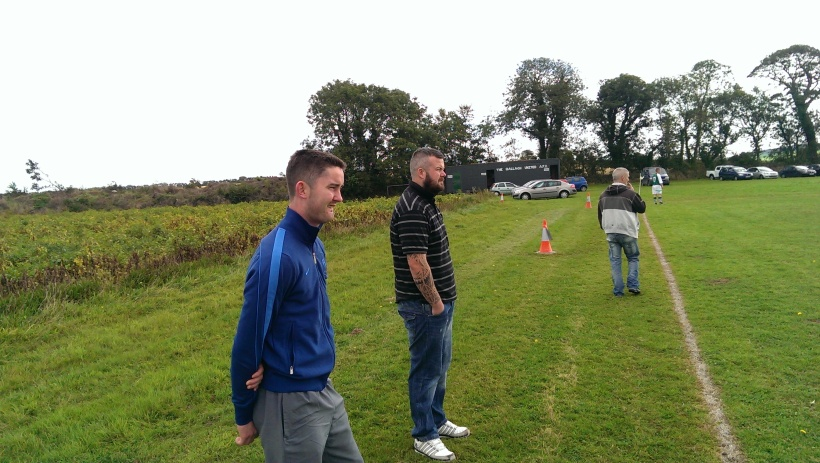 Doc Dunne, Alan Whelan and Eddie Whelan look on in amazement.