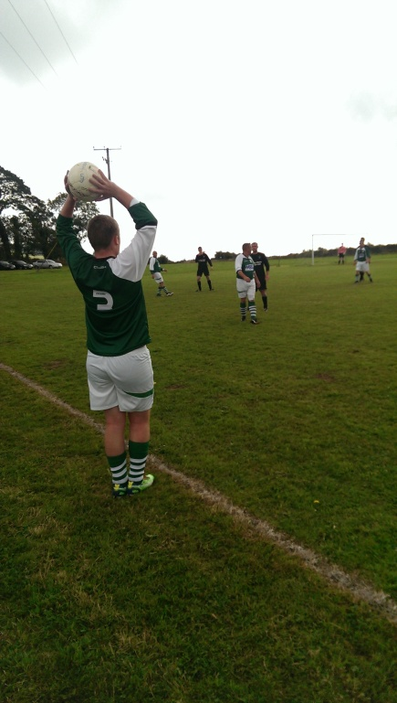 Left back Ciaran O'Neill sends the takes a throw in.